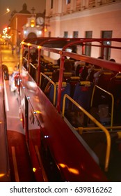 Double deck red bus drive on street at night. Night city bus tourist tour