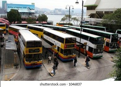 Double decker buses at a bus terminal in Hong Kong.