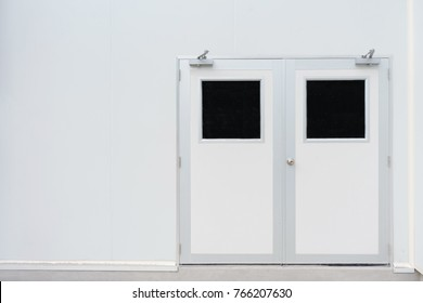 Double door in control room for pharmaceutical or food industry and concrete floor