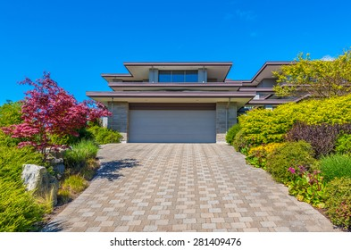 Double doors garage and long nicely paved driveway. North America.