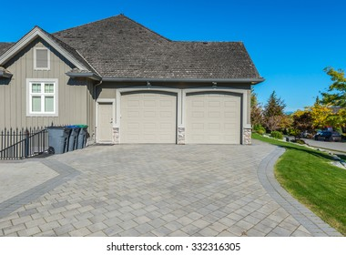 Double doors garage with nicely paved driveway. North America.