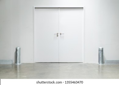Double doors with security lock  in warehouse close up.