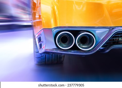 Double exhaust pipes of a sports car