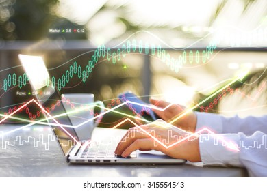 Double explosure with business chart and businessman with laptop at sunrise