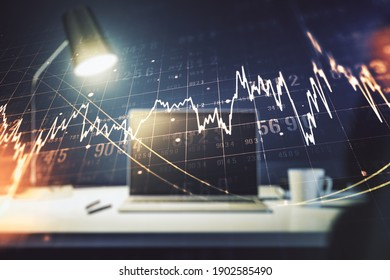 Double exposure of abstract creative financial diagram on modern laptop background, banking and accounting concept