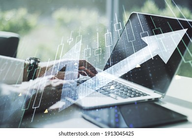 Double exposure of abstract creative financial diagram with upward arrow and hands typing on computer keyboard on background, growth and development concept