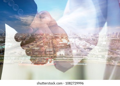 Double exposure arabianman with buisinessman hand shaking with oil refinery and Petrochemical plant at dusk.