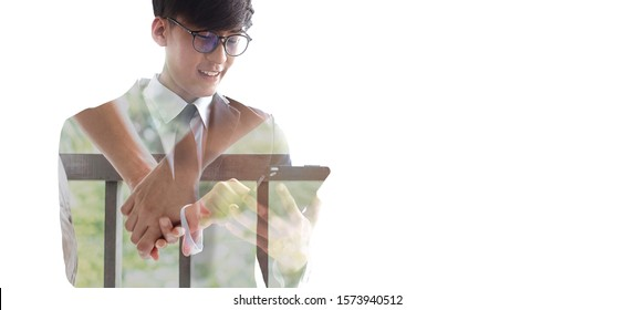 Double exposure of Asian man in business suit working on smartpone  layered with hands holding couple. The double exposure depict work life balance. Long distance relationship & togetherness concept.