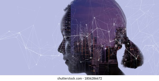 Double exposure of Asian woman silhouette and modern renewable city skyline background.Energy Digitalization concept.