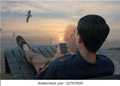 Double exposure of Back side view of man relaxing on the beach outdoors background using smartphone, luxury relaxation concept
