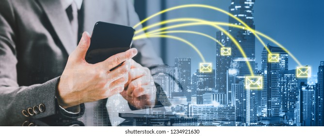 Double exposure banner of entrepreneur businessman using smartphone sending email on cityscape background. Business communication, internet information technology, or mobile e-mail application concept