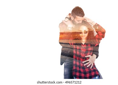 Double exposure of beautiful couple hugging and seascape sunset