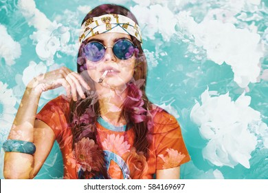 Double exposure of beautiful hippy girl smoking weed and flowers
