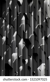 Double exposure of building exterior fragment with convex and concave elements. Architectural surfaces in black and white. Realistic though unreal modern architecture with angular geometric structure.