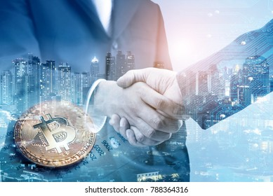 Double exposure of business handshake and bitcoin BTC the new virtual electronic money with blur city night, investment concept