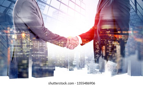 Double exposure with business handshaking of two businessmen on Singapore skyline.