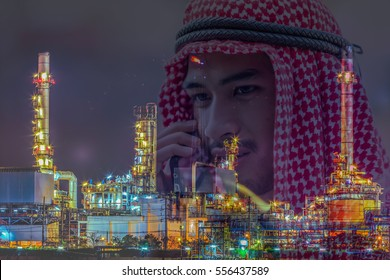 Double exposure of business handsome Arab man use smart phone and Oil refinery background