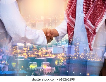 Double exposure of business handsome Arab man hand shake and Oil refinery background