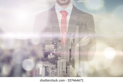 Double exposure with business man and city skyline. Man reflecting himself in the window and watching the skyline from his office