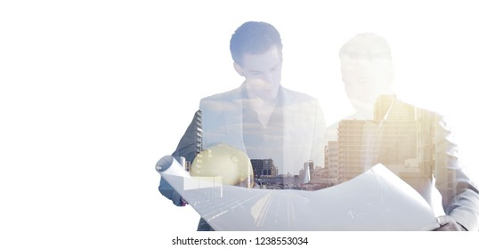 Double exposure Business man and construction manager looking at the blueprint and discuss documentation about new project building in the City. Concept of Business ,Construction,  Teamwork