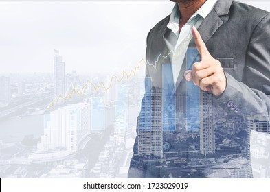 double exposure business man draw growth chart with cityscape background. concept for business working and leadership success with strategy plan management idea.