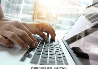 Double exposure of business man hand working on blank screen laptop computer on wooden desk as concept