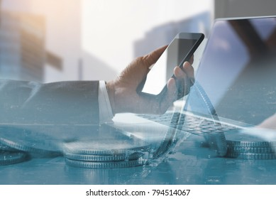 Double exposure, business man using mobile smartphone and laptop computer internet payment and financial background, financial technology, FinTech concept