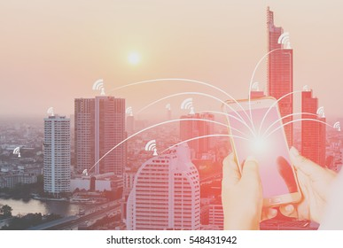 Double exposure business mand on financial city and money coins. Global investment and growth network concept