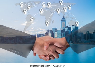 Double exposure of business people handshake greeting deal concept on blue tone of cityscape business district background with map pin flat network conection on world global cartography globalization.