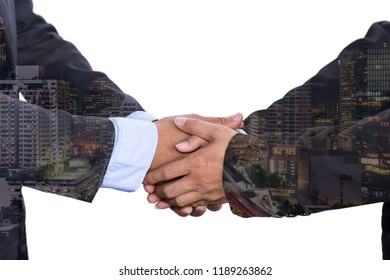 Double exposure business people shake hand in meeting Asian style on city night background