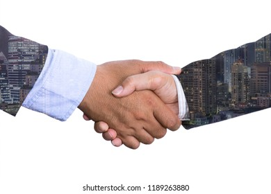 Double exposure business people shake hand in meeting on city night background