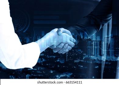 double exposure Business people shaking hands after closing deal in office, partnership merger and acquisition concept