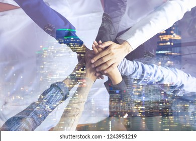 Double exposure Business  success Team which hand of the work force combine power tag team with light and Group of diversity people hand assembly together for good teamwork.