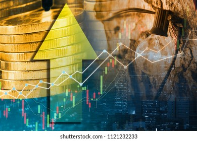 Double exposure business trading graph on money pile coins and light bulb decor