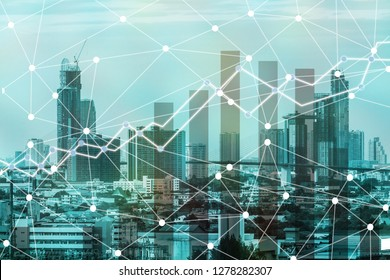 Double exposure business trading graph and network connection on city background.