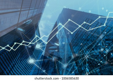 double exposure business trading investment graph on city background.