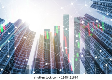 Double exposure business trading network graph on modern city capital financial building background