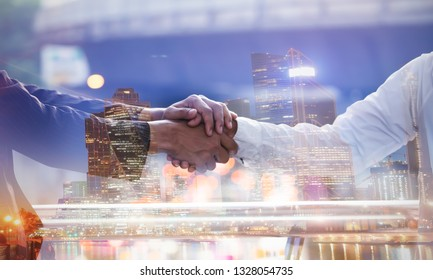 Double exposure Business trust commitment which Business Partners holding hands for Help, trust,support,empathy and factors relationship marketing for reach successful commit concept.