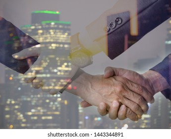 Double exposure Business trust commitment which Business Partners holding hands with Help, trust ,support ,empathy and factors relationship marketing for reach successful achievement  commit concept.