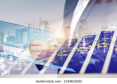 Double exposure of business woman check investment or sale report with graph data and city night background