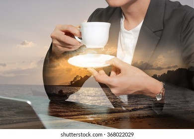 Double exposure of business woman drink a coffee,tea and sunrise on the beach.