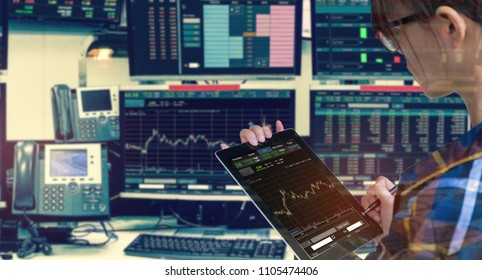 Double exposure of business woman holding tablet for Stock market quotes and chart in monitor computer room with business office equipments .business and money trading concept.
