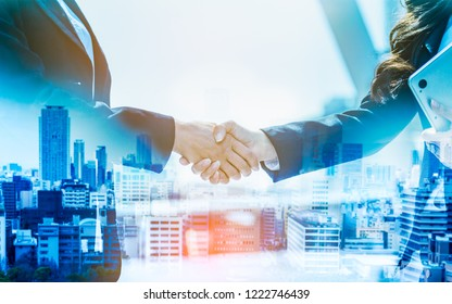 Double exposure business women hand shake teamwork brainstorming with innovation business. concept success investment.Business People Handshake Greeting Deal Concept.