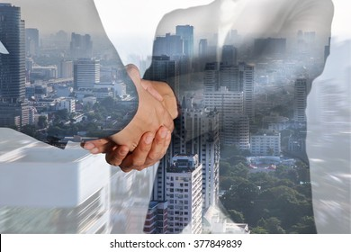 Double exposure of business women double handshake and city in a foggy morning on zoom background as welcome concept.