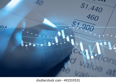 Double exposure of business working items with a digital information for Forex and Stock trading. Business background as concept.