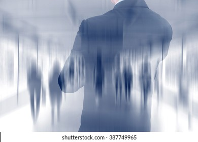 Double exposure of businessman and blurred walking people