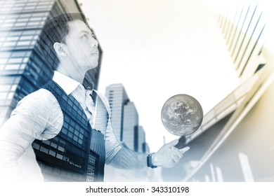 Double exposure of businessman with building, sky and earth, filter by sepia tone, Elements of this image furnished by NASA