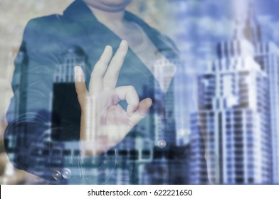 double exposure businessman in city background