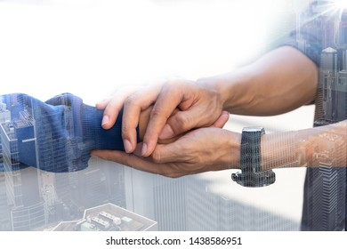 Double exposure of Businessman with client holding hands together for comfort and support work together, insurance team,respect and trust concept