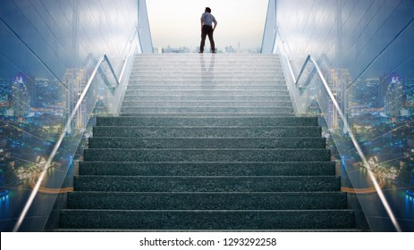 Double exposure businessman climbed on top of the stairs going to the city,  Ambitions concept and Success business.